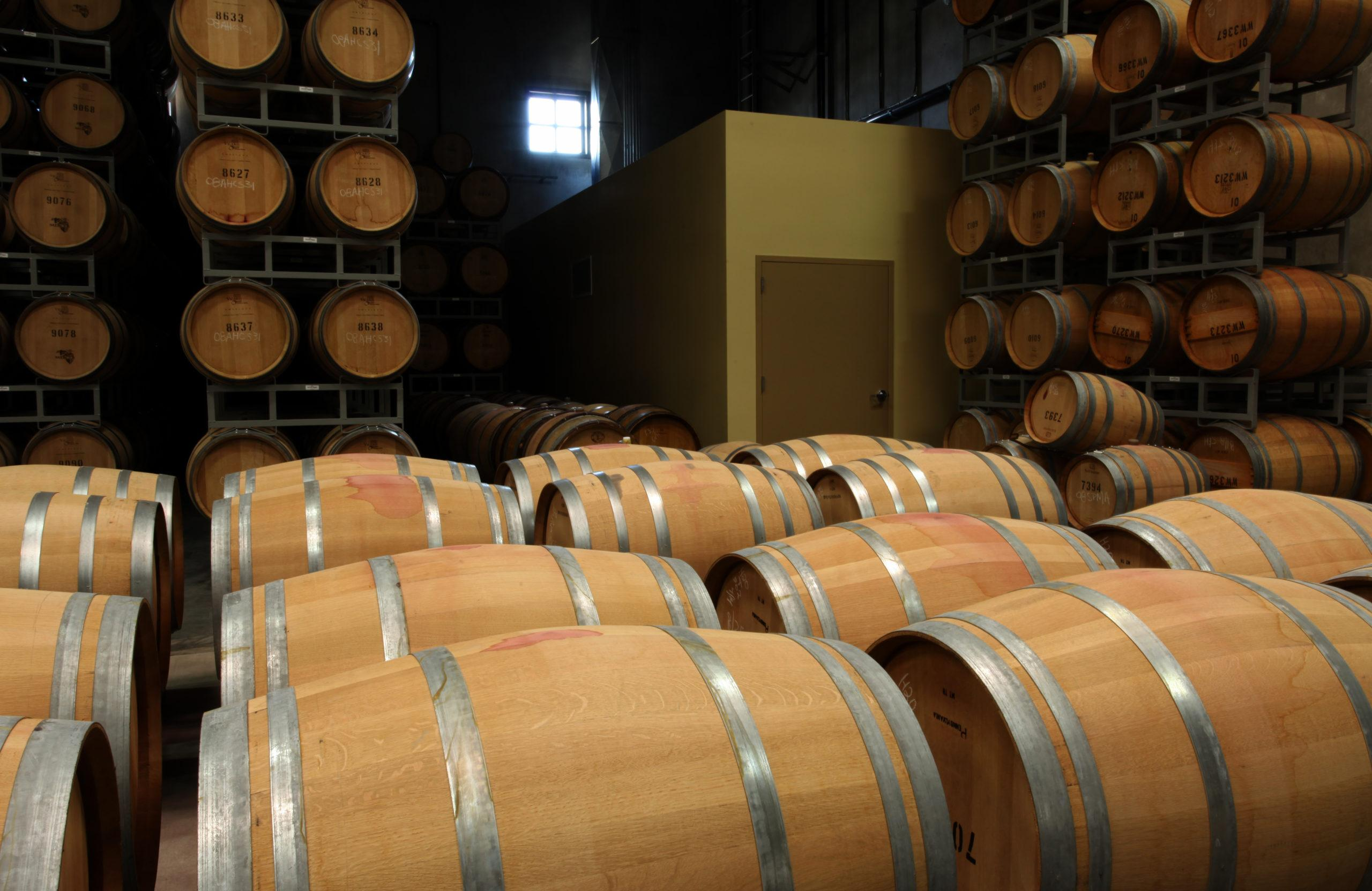 Room with stacks of wine barrels